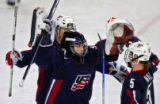U.S. Women's Hockey Team goaltender Chanda Gunn (#30) celebrates with teammates Lyndsay Wall (#5)...