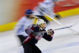 U.S. Women's Hockey Team captain Krissy Wendell (#7) takes off down ice against Finland with a...