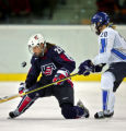 U.S. Women's Hockey Team member Tricia Dunn-Luoma (#25) tries to control an airborne puck as...
