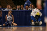 "JPM411  An Air Force Academy  cheerleader and ""The Bird,"" the Academy's mascot, watch..."