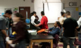 Shantiara Fite, cq, (center sitting) packs her bag as student leave their third period science...
