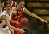 Moffat County High School's MariKatherine Raftopoulas, left, and Regis Jesuit High School's Diana...