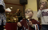 Cancer-survivor Jacob Cohen, 5 of Westminster, eats ice-cream with his sister Rebekah, 7, in the...