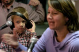 Keegan Smit, left 6, sits with his mother Robyn Smit, of Denver, during a live interview on Alice...