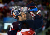 Team U.S.A. goaltender Rick DiPietro cools off after a goal by Team Finland's Olli Jokinen during...