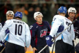 Team U.S.A.'s John-Michael Liles (#27) shakes hands with Team Finland including former Avalanche...