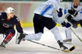 Team U.S.A.'s Brian Rafalski (#28) trips up Team Finland's Olli Jokinen (#12) during the third...