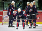 Team U.S.A.'s Mathieu Schneider (#23), Bret Hedicam (#6) and Jason Blake (#55) react as time...