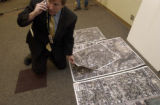 John Leavitt, (cq), Senior Public Communications Specialist for the city, sorts aerial images for...