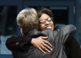 Rhonda Marshall-Fields, face showing, hugs Detective Gretchen Fronapfel Thursday morning March 9,...