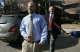 Teacher Jay Bennish leaves the Educational Sevice Center with his attorney David Lane.  Bennish...