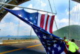 NYT20 - (NYT20) FORT MONTGOMERY, NY -- July 2, 2004 -- NY-FOURTH-FLAG -- Workers on Bear Mountain...
