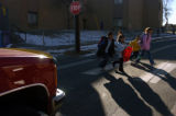 (l-r) Students from Valdez Elementary cross Dunkeld Street after school Tuesday, Feb. 21, 2006....