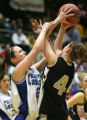 Laine Baity, left, of Denver Christian, left, and Caitlin Forrest, right, of Pagosa Springs, fight...