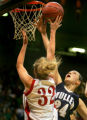 Mindy Nielson (#32), of Regis, has her shot blocked by Meghan Hurley (#24), of Mullen in the first...