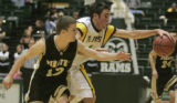 Pagosa Springs guard Paul Przybylski, left, and Roaring Forks guard Klade Gianinetti, right, chase...