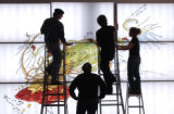 (LT. TO RT.) Denver Art Museum exhibition installers John Lupe (CQ) and Art Bernal (CQ), work with...