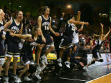 The Mullen bench erupts after Mullen won the 4a Girls Basketball State Championship against Regis...