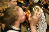 Carrie Wagner, of Mullen, kisses the trophy after Mullen won the 4a Girls Basketball State...