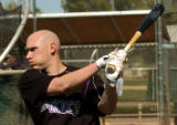 Rockies infielder Clint Barmes warms up for some batting during practice Friday morning February...