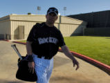 Rockies Todd Helton heads for the first day of practice Friday morning February 24, 2006 at Hi...