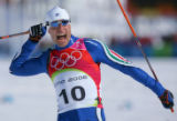 Giorgio di Centa, of Italy, celebrates after winning the gold medal in the men's 50KM Cross...
