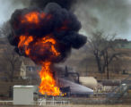 Firefighters battle a blaze from a burning gas compressor station south west of Fort Lupton...
