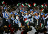 U.S. Olympic athletes enter the Stadio Olimpico amidst a sea of Italian flags during the Closing...