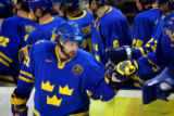 Sweden's Peter Forsberg (#21) gets some congratulations from teammates after assisting on the game...