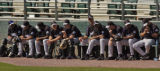 Rockies  pitchers and catchers wait for their turn to get some game action Monday afternoon...