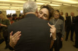 Fred J. Oliva, hugs Deputy Margaret Gomez, (cq both), Director of Corrections and Undersheriff...