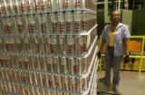 Sonji Clark puts tickets on pallets of finished cans. These are 24oz cans and there are 4,082 on...
