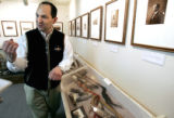 Christopher Kortlander, Director of the Custer Battlefield Museum stands by an exhibit of David F....