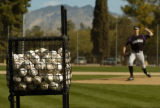 Rockies picture Jeff Francis throws to home during practice Tuesday morning February 28, 2006 at...
