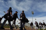 Colorado Rockies players head to the field, for the last practice before pre-season games begin,...