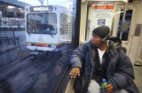 Terrell Mitchell (cq) looks out of an RTD bus window  at 6 AM on Wednesday March 15, 2006. He was...