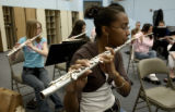 COMMERCE CITY., Colo., Mar. 1, 2006) Senior, Tiyana Hardney ,cq, plays the flute Wednesday Mar. 1,...