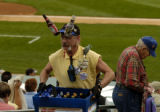 Captain Earthman sells beer during the game at Tucson Electric Park Wednesday afternoon March 1,...