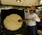 Blu Pahdocony (cq) makes some Kettle corn before the game at Tucson Electric Park Wednesday...
