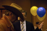 Marc Holtzman, right, talks with Larry Wirth, a rancher from Deer Creek Canyon, after announcing...