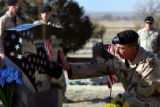 First Sergeant Duane Smith of Lightning Troop, 3ACR, touches SSG Justin Vasquez' headstone after a...