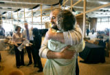 Greg Myers (cq, center left), 33, hugs his wife Kara (cq, center right) after learning he was...