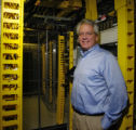 Alf Gardner (cq), President and CEO of Comfluent, has his picture taken with the Fiber...