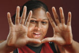 Courtney Paris' hands are an asset to the University of Oklahoma (OU) women's college basketball...