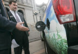 State Senator Brandon C. Shaffer (D) Longmont, middle, examines an ethanol-powered Chevy Avalanche...