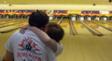 King Sooper employees Matt Mondragon, left, and Sarah Nelson snuggle between rounds of bowling to...