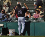 Rockies manager Clint Hurdle talks to fans between innings at Hi Corbett Field March 2, 2006. The...