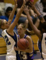 Fort Collins' Julie Foster gets caught between the double press of Highlands Ranch's Abby...