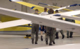 (COLORADO SPRINGS, Colorado... June 15, 2004) Air Force Cadets walk by gliders in a hanger on the...