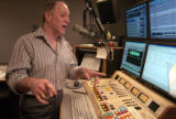 Dennis Harrington (cq), a DJ for Jones Radio Network, broadcasts his daily oldies show from the...